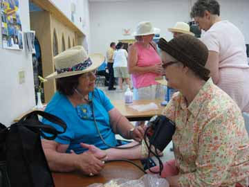 Nurses who are members of the Health & Wellness Advocacy Team gave blood pressure checks to members of the congregation who wished them.