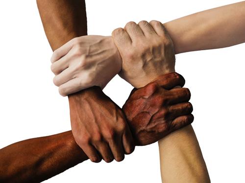 multi-racial hands linked